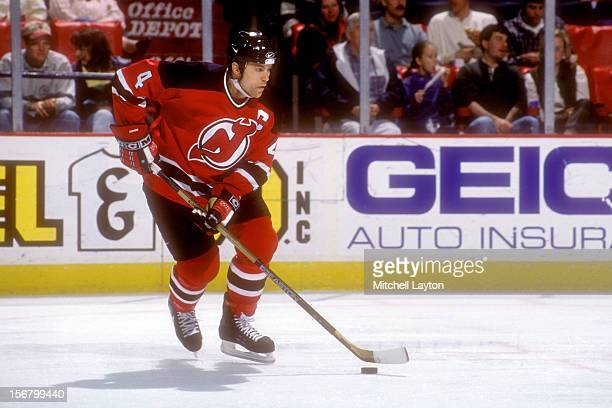 Scott Stevens of the New Jersey Devils skates with the puck a hockey game against the Washington Capitals on February 24 1996 at the USAir Arena in...