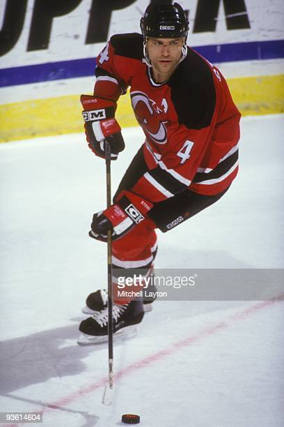 Scott Stevens of the New Jersey Devils skates with the puck during a NHL hockey game against the Washington Capitals on Janaury 14 1994 at USAir...