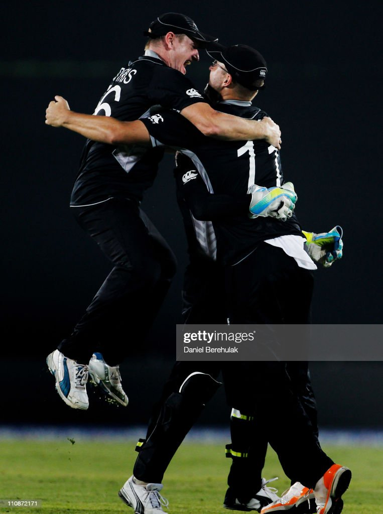 Scott Styris of New Zealand jumps into Daniel Vettori's arms after Luke Woodcock of New Zealand took the wicket of Morne Morkel of South Africa to...