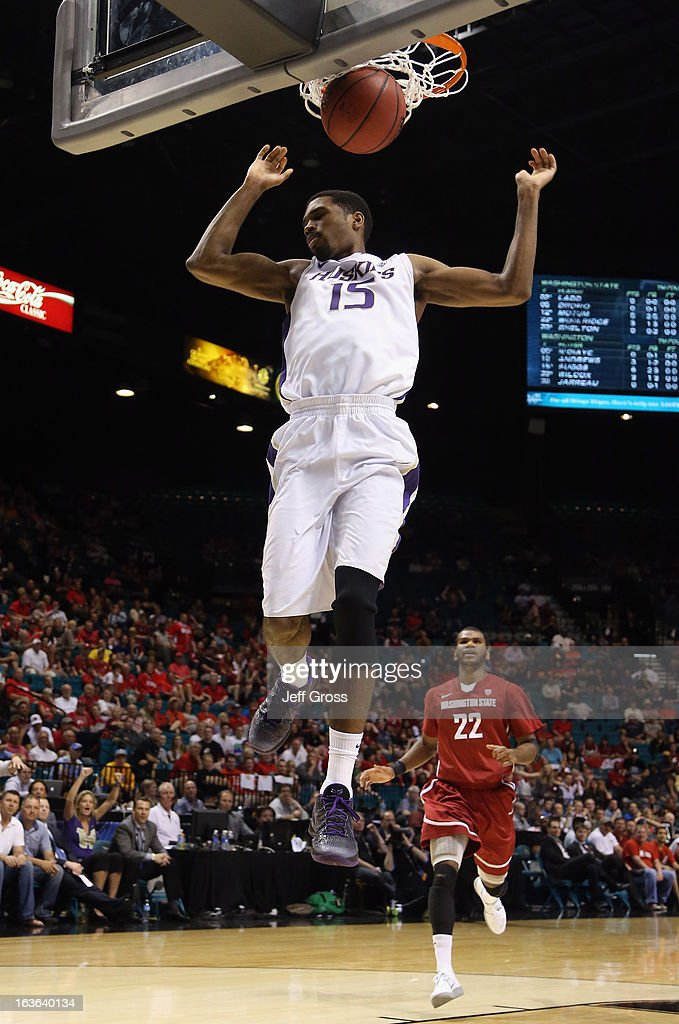 Scott Suggs #15 of the Washington Huskies dunks the ball in the first half against the Washington State Cougars during the first round of the Pac 12 Tournament at the MGM Grand Garden Arena on March 13, 2013 in Las Vegas, Nevada.