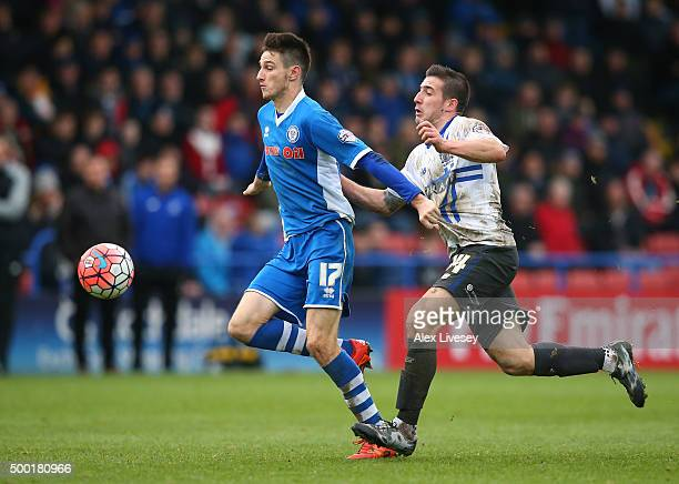 Scott Tanser of Rochdale holds off a challenge from Craig Jones of Bury during The Emirates FA Cup Second Round match between Rochdale and Bury at...