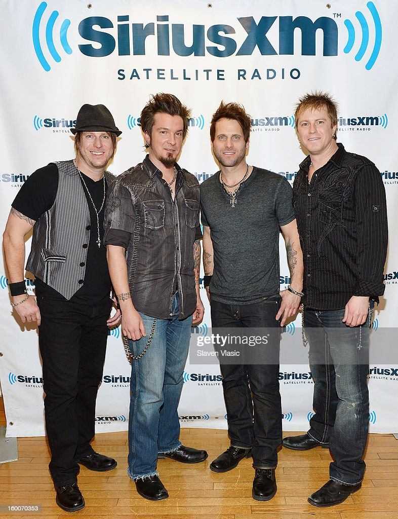 <a gi-track='captionPersonalityLinkClicked' href=/galleries/search?phrase=Scott+Thomas+-+Drummer+-+Parmalee&family=editorial&specificpeople=14520667 ng-click='$event.stopPropagation()'>Scott Thomas</a>, Josh McSwain, Matt Thomas and Barry Know of Country rock band 'Parmalee' visit SiriusXM Studios on January 25, 2013 in New York City.