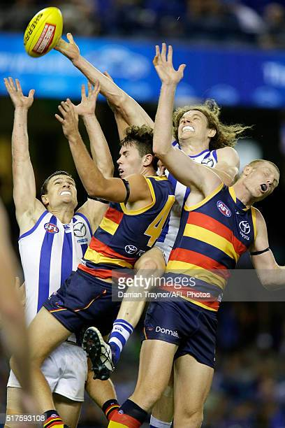 Scott Thompson and Ben Brown of the Kangaroos compete for the ball with Mitchell McGovern and Sam Jacobs of the Crows during the round one AFL match...