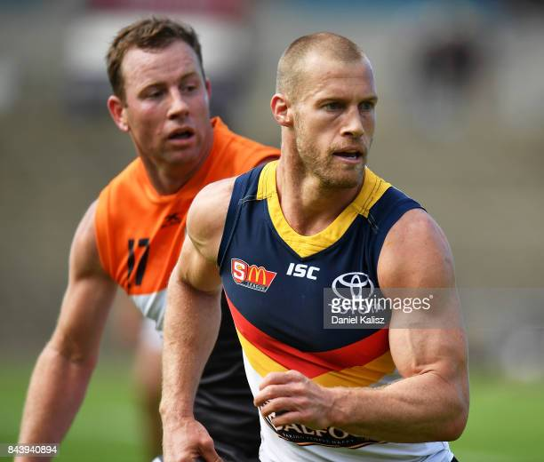 Scott Thompson of the Crows and Steve Johnson of the Giants compete for the ball during a practice match between the Greater Western Sydney Giants...