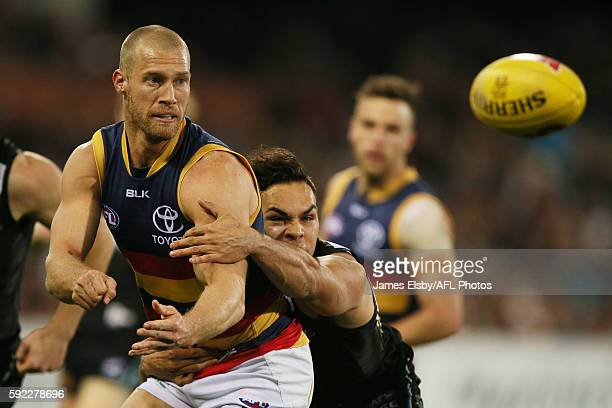 Scott Thompson of the Crows is tackled by Jarman Impey of the Power during the 2016 AFL Round 22 match between Port Adelaide Power and the Adelaide...