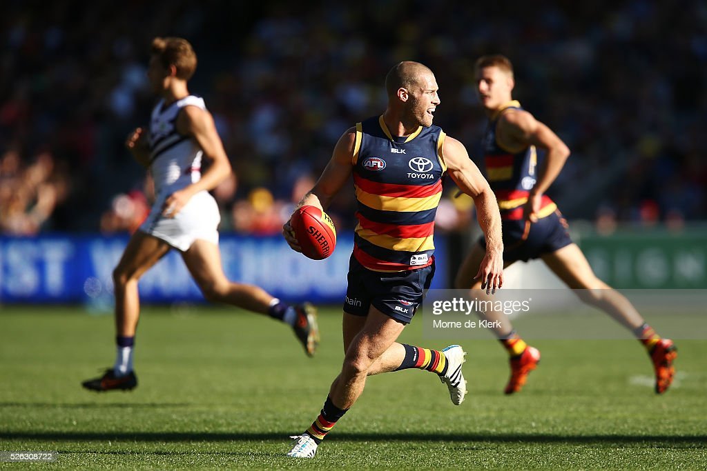 Scott Thompson of the Crows runs with the ball during the round six AFL match between the Adelaide Crows and the Fremantle Dockers at Adelaide Oval on April 30, 2016 in Adelaide, Australia.