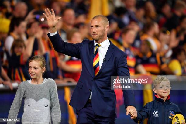 Scott Thompson of the Crows waves to the crowd during his lap of honour during half time during the First AFL Preliminary Final match between the...