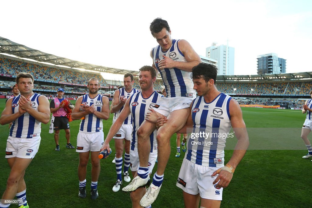 Scott Thompson of the Kangaroos is chaired from the field after his 200th match during the round 23 AFL match between the Brisbane Lions and the North Melbourne Kangaroos at The Gabba on August 26, 2017 in Brisbane, Australia.