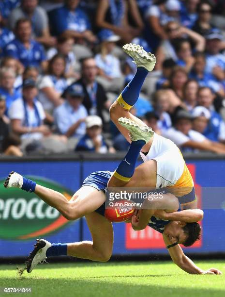 Scott Thompson of the Kangaroos is tackled by Jack Darling of the Eagles during the round one AFL match between the North Melbourne Kangaroos and the...