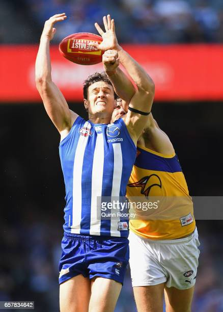 Scott Thompson of the Kangaroos marks infront of Josh Kennedy of the Eagles during the round one AFL match between the North Melbourne Kangaroos and...