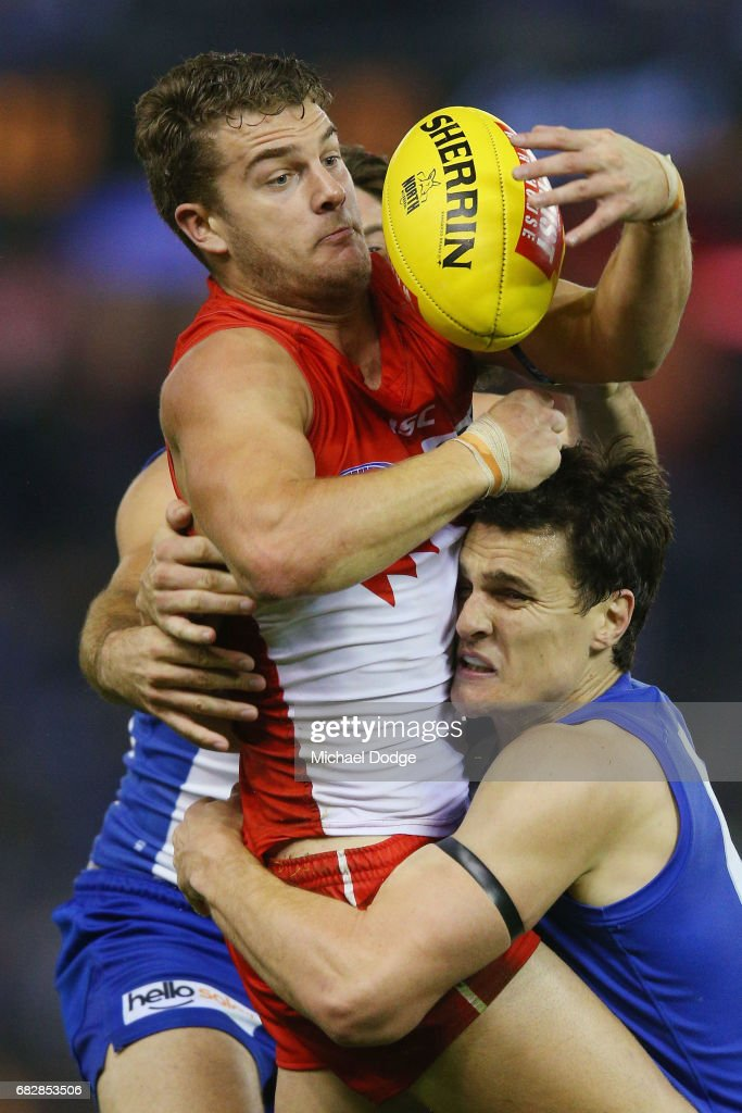 Scott Thompson of the Kangaroos tackles Tom Papley of the Swans during the round eight AFL match between the North Melbourne Kangaroos and the Sydney Swans at Etihad Stadium on May 14, 2017 in Melbourne, Australia.