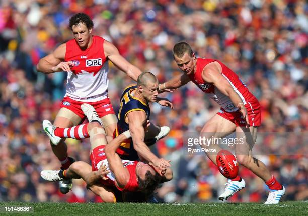 Scott Thomspon of the Crows clashes with Jude Bolton of the Swans during the Second AFL Qualifying Final match between the Adelaide Crows and the...