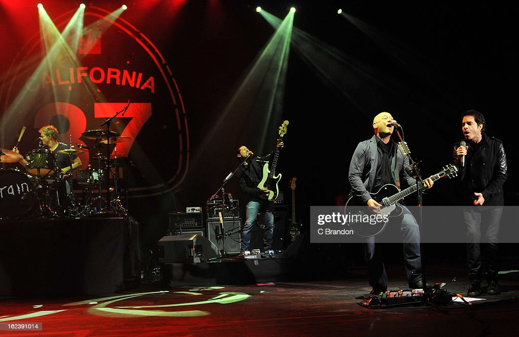 Scott Underwood, Hector Maldonado, Jimmy Stafford and Pat Monahan of Train perform on stage at Hammersmith Apollo on February 22, 2013 in London, England.