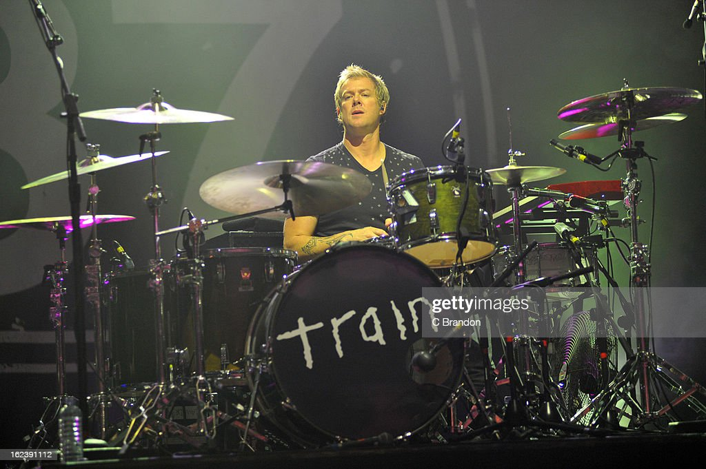 Scott Underwood of Train performs on stage at Hammersmith Apollo on February 22, 2013 in London, England.