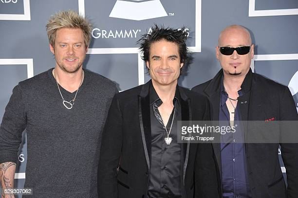 Scott Underwood Rob Hotchkiss and Jimmy Stafford of the band Train arrive at the 53rd Annual Grammy Awards held at the Staples Center