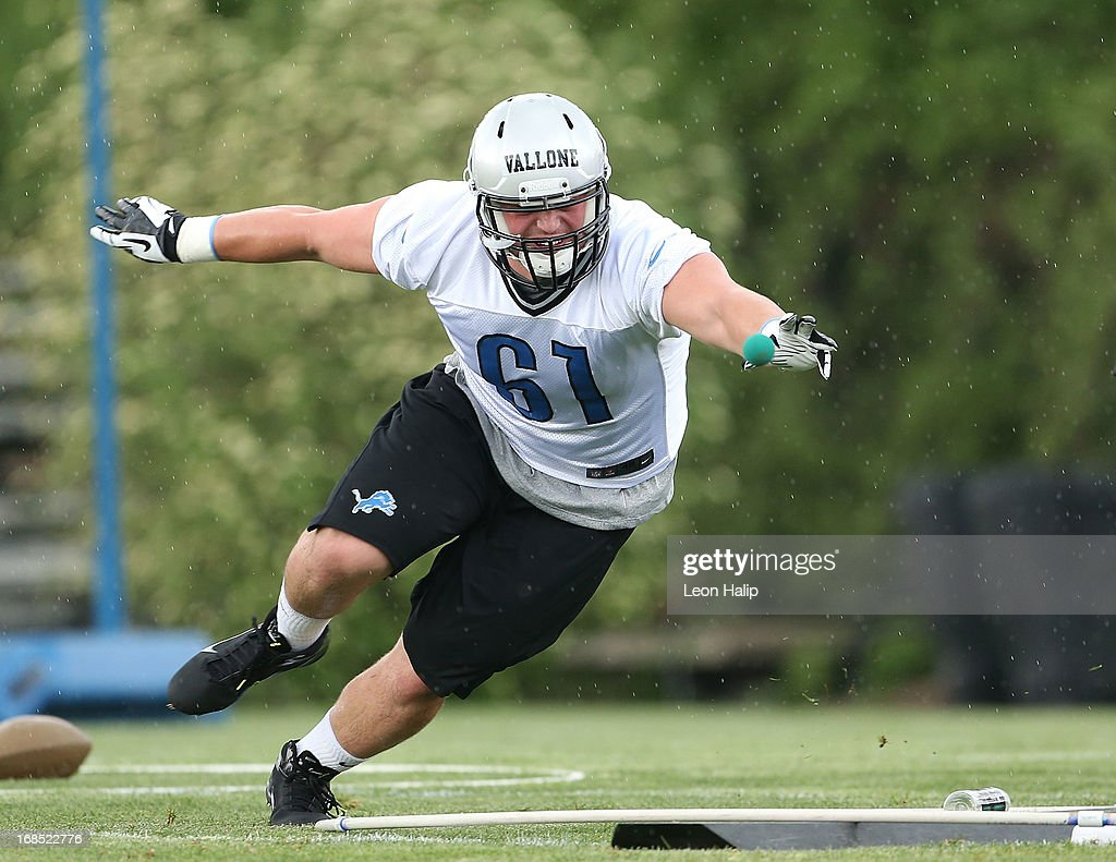 Scott Vallone #61 of the Detroit Lions goes through the afternoon drills during the first day of Rookie Camp on May 10, 2013 in Allen Park, Michigan.