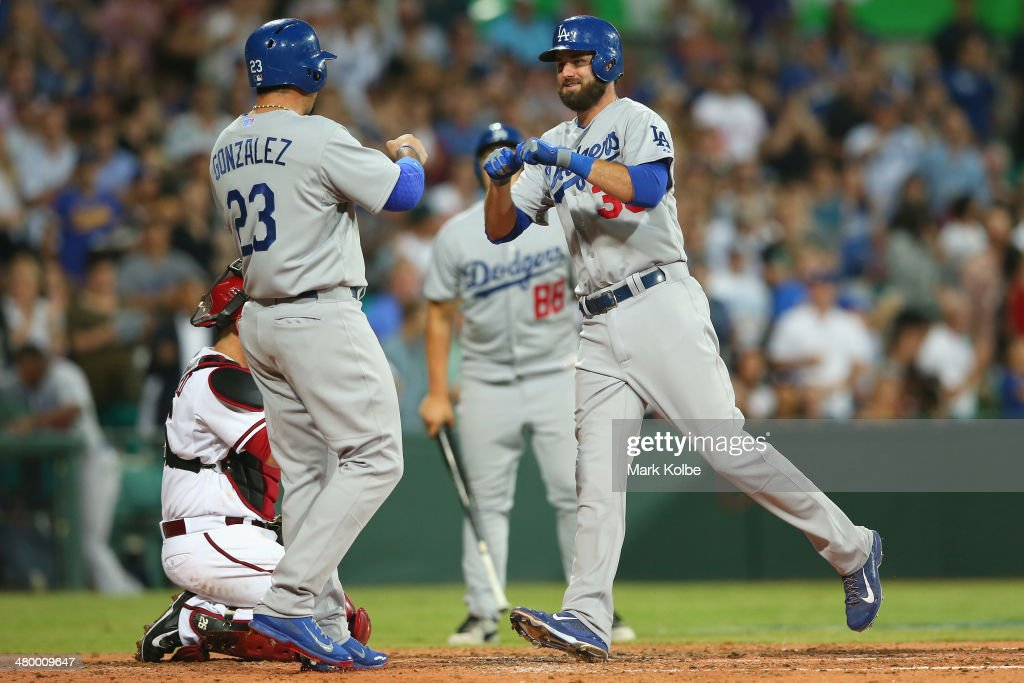 Scott Van Slyke of the Dodgers celebrates a home run during the opening match of the MLB season between the Los Angeles Dodgers and the Arizona Diamondbacks at Sydney Cricket Ground on March 22, 2014 in Sydney, Australia.