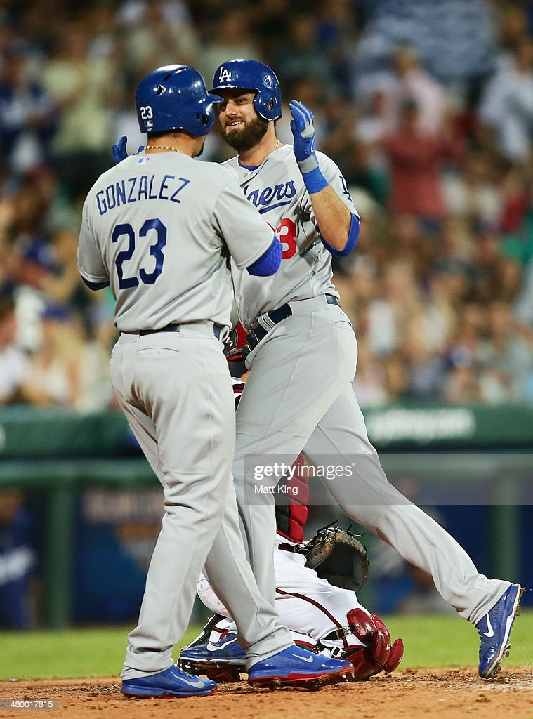 Scott Van Slyke (R) of the Dodgers celebrates with Adrian Gonzalez (L) after hitting a two run home run during the opening match of the MLB season between the Los Angeles Dodgers and the Arizona Diamondbacks at Sydney Cricket Ground on March 22, 2014 in Sydney, Australia.