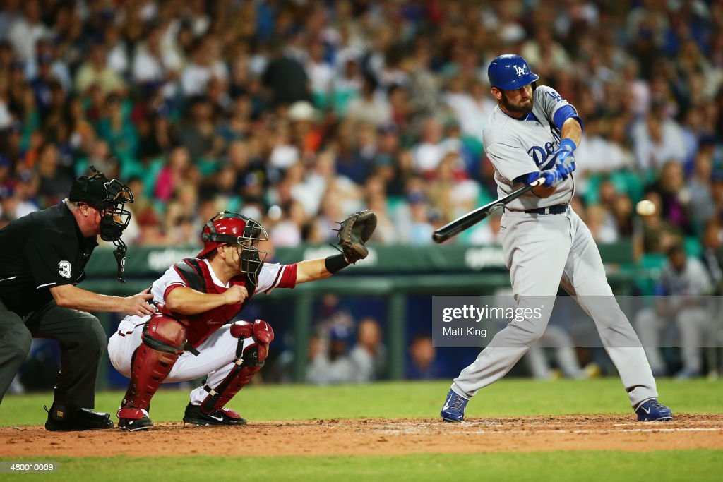 Scott Van Slyke of the Dodgers hits a two run home run during the opening match of the MLB season between the Los Angeles Dodgers and the Arizona Diamondbacks at Sydney Cricket Ground on March 22, 2014 in Sydney, Australia.