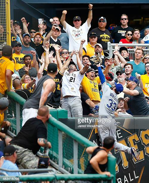 Scott Van Slyke of the Los Angles Dodgers leaps into the left field stands but fails to come up with the home run hit by Francisco Liriano of the...