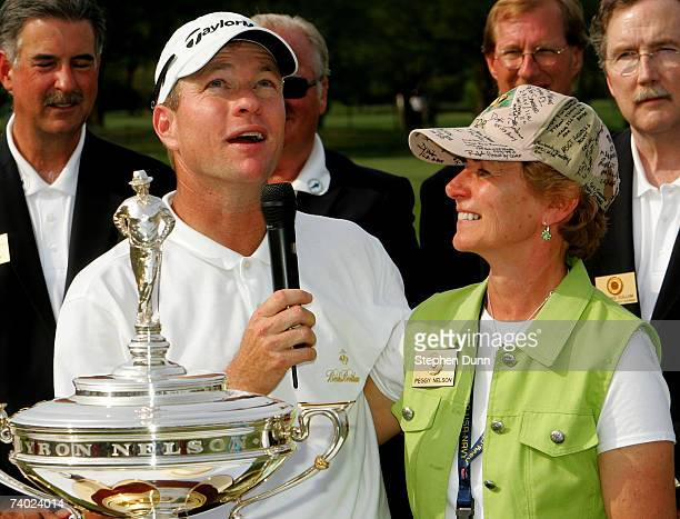 Scott Verplank looks skyward as he speaks of the late Byron Nelson standing with Nelson's widow Peggy Nelson after winning the EDS Byron Nelson...