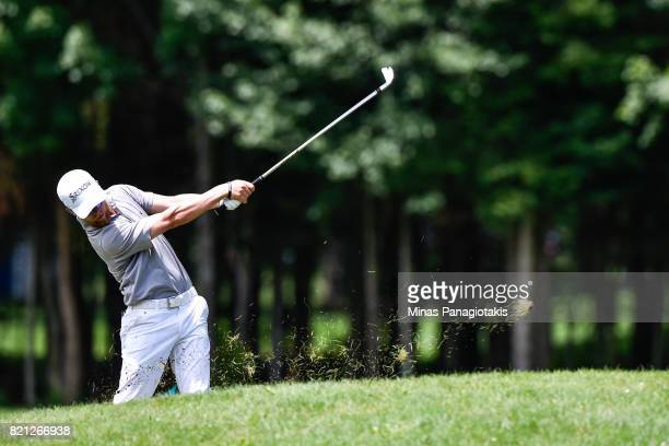 Scott Vincent of Zimbabwe hits his approach shot from the rough on the seventh hole during the final round of the Mackenzie Investments Open at Club...