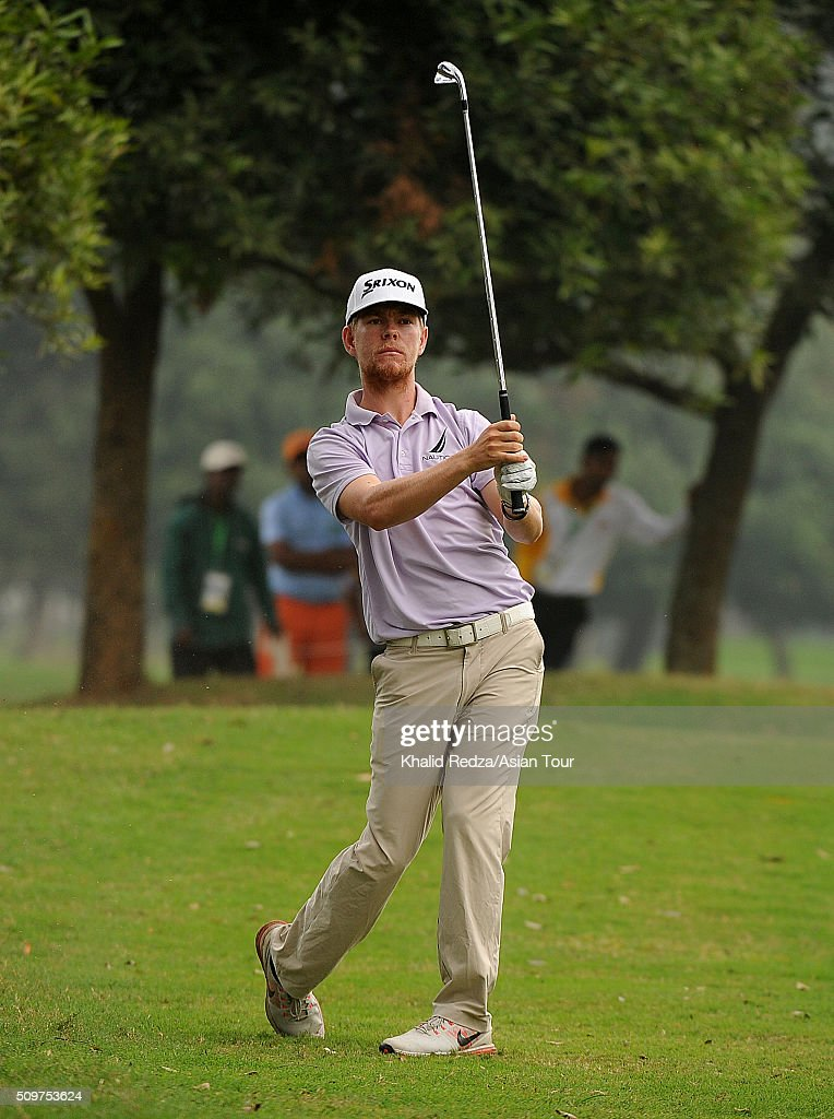 Scott Vincent of Zimbabwe plays a shot during round three of the Bashundhara Bangladesh Open at Kurmitola Golf Club on February 12, 2016 in Dhaka, Bangladesh.