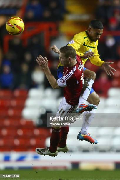 Scott Wagstaff of Bristol City feels the force of a challenge from Jordan Clarke of Coventry City during the Sky Bet League One match between Bristol...