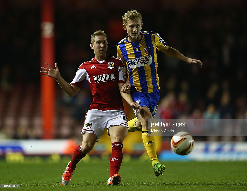 Scott Wagstaff (L) of Bristol City loses out to George Saville (R) of Brentford during the Sky Bet League One match between Bristol City and Brentford at Ashton Gate on October 22, 2013 in Bristol, England.