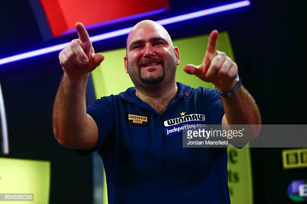Scott Waites of England celebrates winning the Men's final match against Jeff Smith of Canada during Day Nine of the BDO Lakeside World Professional...