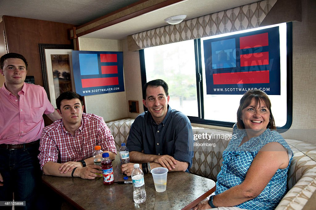 <a gi-track='captionPersonalityLinkClicked' href=/galleries/search?phrase=Scott+Walker+-+Politician&family=editorial&specificpeople=7511934 ng-click='$event.stopPropagation()'>Scott Walker</a>, governor of Wisconsin and 2016 Republican presidential candidate, smiles as he sits on his campaign bus during photo-op with his wife Tonette and son Alex, seated, and Matt, following a campaign stop in Davenport, Iowa, U.S., on Friday, July 17, 2015. Wisconsins top court killed a criminal investigation of Walkers 2012 election campaign, removing a potential stumbling block to his presidential bid. Photographer: Daniel Acker/Bloomberg via Getty Images