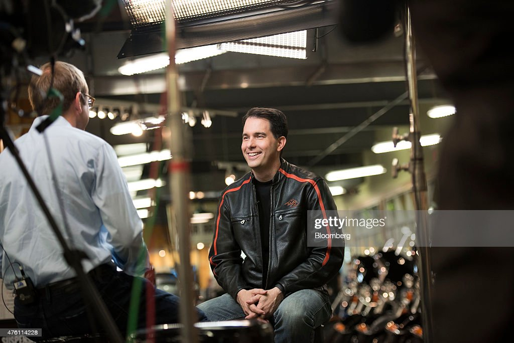 <a gi-track='captionPersonalityLinkClicked' href=/galleries/search?phrase=Scott+Walker+-+Politician&family=editorial&specificpeople=7511934 ng-click='$event.stopPropagation()'>Scott Walker</a>, governor of Wisconsin, smiles during a television interview in the showroom of Big Barn Harley Davidson in Des Moines, Iowa, U.S., on Saturday, June 6, 2015. Iowa Senator Joni Ernst is hosting the inaugural Roast and Ride event which featured a 38-mile ride from a Des Moines Harley Davidson dealership to the Central Iowa Expo where seven current and potential Republican presidential candidates are expected to speak. Photographer: Daniel Acker/Bloomberg via Getty Images