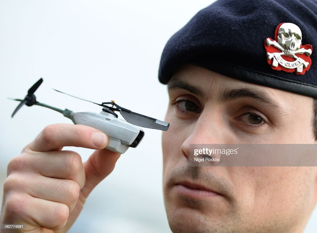 SGT Scott Weaver poses with the tiny unmanned aircraft Black Hornet, used by the Army in Afghanistan at RAF Waddington on January 15, 2014 in Waddington, England. RAF Waddington has two Ground Control Stations operating unmanned aircraft systems in Afghanistan, including the RAF's Reaper aircraft. The unmanned aircraft systems, often referred to as drones, include current and future equipment such as Hermes 450, Black Hornet Nano, Tarantula Hawk, Watchkeeper and Scan Eagle.