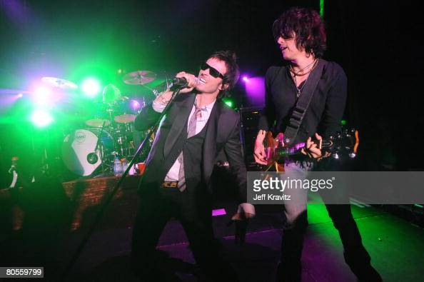 Scott Weiland and Dean DeLeo of Stone Temple Pilots perform during the Stone Temple Pilots tour announcement and performance held at a private...