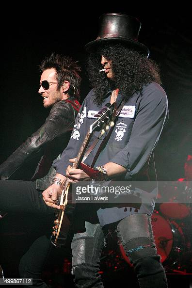 Scott Weiland and Slash of Velvet Revolver perform at the Gibson Amphitheater on December 12 2007 in Los Angeles California