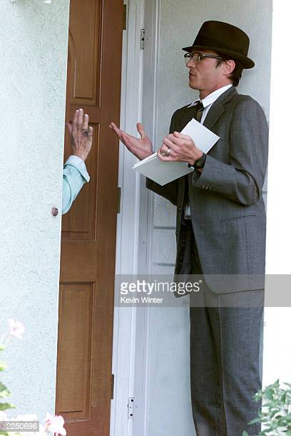 Shangri la dee da stock photos and pictures getty images for Door to door salesman