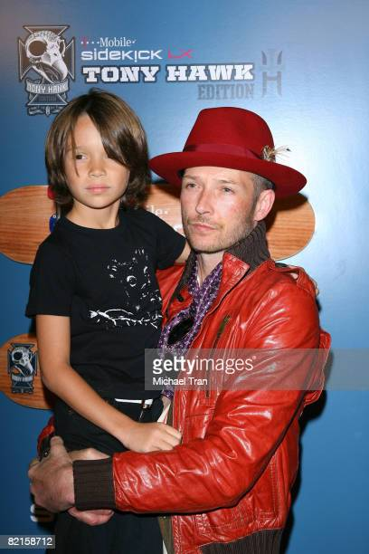 Scott Weiland of the band 'Stone Temple Pilots' and his son Noah Mercer Weiland arrive at the TMobile Sidekick LX 'Tony Hawk' edition launch party...