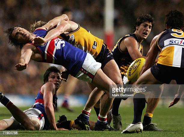 Scott West of the Bulldogs is taken high in a tackle during the AFL First Semifinal match between the West Coast Eagles and the Western Bulldogs at...
