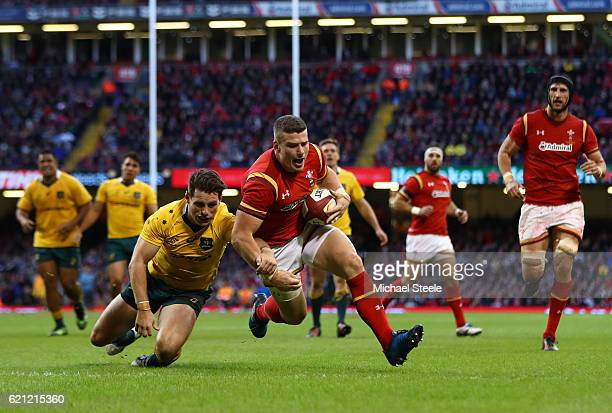Scott Williams of Wales gathers his own kick ahead to score his team's first try during the international match between Wales and Australia at the...