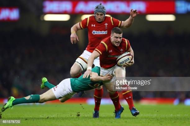 Scott Williams of Wales is tackled by Garry Ringrose of Ireland during the Six Nations match between Wales and Ireland at the Principality Stadium on...