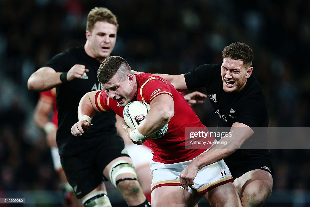 <a gi-track='captionPersonalityLinkClicked' href=/galleries/search?phrase=Scott+Williams+-+Rugby+Player&family=editorial&specificpeople=12536775 ng-click='$event.stopPropagation()'>Scott Williams</a> of Wales is tackled by <a gi-track='captionPersonalityLinkClicked' href=/galleries/search?phrase=Tawera+Kerr-Barlow&family=editorial&specificpeople=5538648 ng-click='$event.stopPropagation()'>Tawera Kerr-Barlow</a> of New Zealand during the International Test match between the New Zealand All Blacks and Wales at Forsyth Barr Stadium on June 25, 2016 in Dunedin, New Zealand.