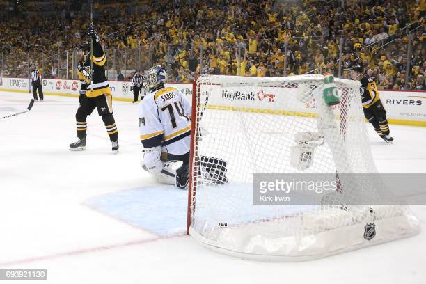 Scott Wilson of the Pittsburgh Penguins celebrates his team's fifth goal by Phil Kessel against the Nashville Predators in Game Five of the 2017 NHL...