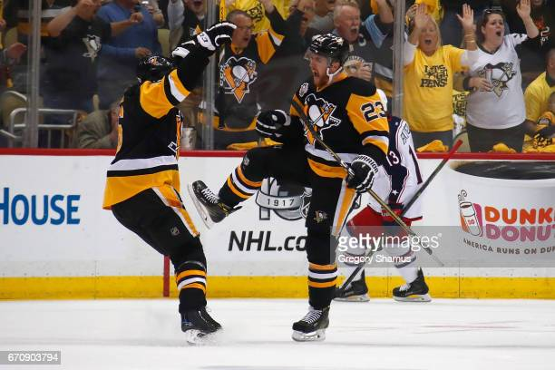 Scott Wilson of the Pittsburgh Penguins celebrates his third period goal with Trevor Daley while playing the Columbus Blue Jackets in Game Five of...