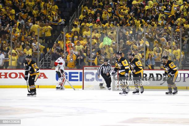 Scott Wilson of the Pittsburgh Penguins celebrates with his teammates after scoring a goal against Craig Anderson of the Ottawa Senators during the...