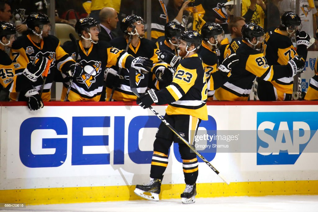 Scott Wilson #23 of the Pittsburgh Penguins celebrates with his teammates after scoring a goal against Craig Anderson #41 of the Ottawa Senators during the first period in Game Five of the Eastern Conference Final during the 2017 NHL Stanley Cup Playoffs at PPG PAINTS Arena on May 21, 2017 in Pittsburgh, Pennsylvania.