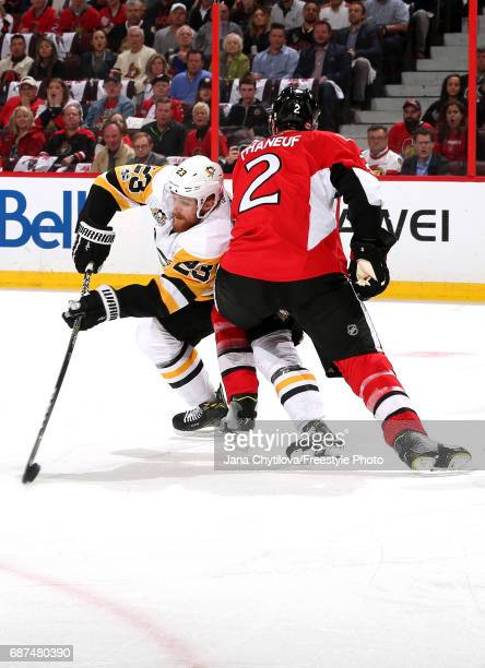 Scott Wilson of the Pittsburgh Penguins collides with Dion Phaneuf of the Ottawa Senators during the first period in Game Six of the Eastern...
