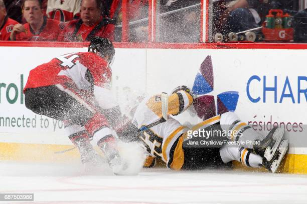 Scott Wilson of the Pittsburgh Penguins falls to the ice against JeanGabriel Pageau of the Ottawa Senators during the second period in Game Six of...