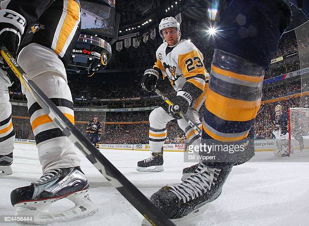 Scott Wilson of the Pittsburgh Penguins follows the play along the boards during an NHL game against the Buffalo Sabres at the KeyBank Center on...