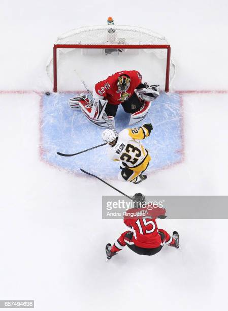Scott Wilson of the Pittsburgh Penguins hits the post on a scoring chance against Craig Anderson and Zack Smith of the Ottawa Senators in Game Six of...