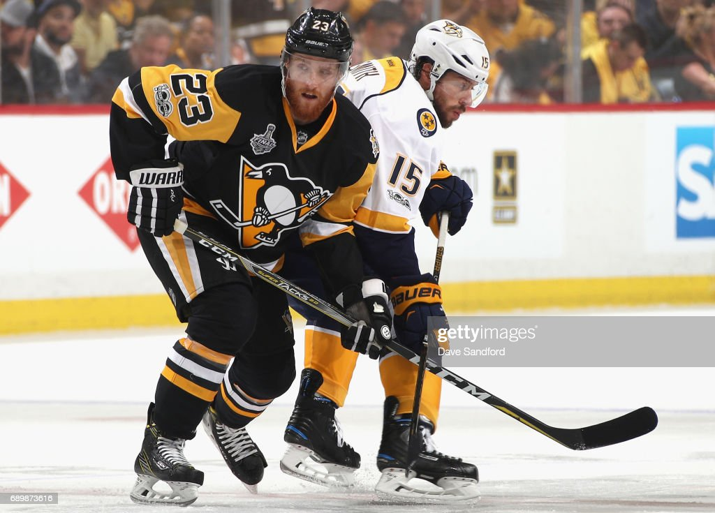 Scott Wilson #23 of the Pittsburgh Penguins plays against Craig Smith #15 of the Nashville Predators during the first period of Game One of the 2017 NHL Stanley Cup Final at PPG Paints Arena on May 29, 2017 in Pittsburgh, Pennslyvannia.